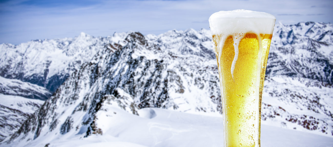 Glass of beer in front of the mountains